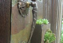 fountains and door knockers  / by Tiffany Charlton