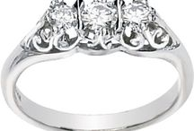 Moissanite Three Stone Rings / by Joy Jewelers