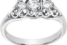 Moissanite Three Stone Rings / by Joy Jewelers