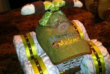 Baby Shower - Diaper Cakes / Adorable creations made with diapers and other baby accessories for either a gift or a centerpiece. / by Therese Scribner