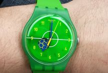 Entusiasmo / ENTUSIASMO (SUOZ175) testifies to Swatch's passionate belief in the values and importance of sports. This New Gent Lacquered takes up the colors of the flag of Brazil: green, yellow, blue and white. The flag is also represented on the exchangeable loop around the strap and available for 31 countries. - http://swat.ch/1kPkSDZ / by Swatch