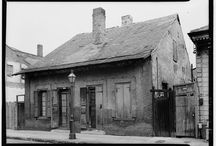French Frames / French Colonial Architecture 1700-1830, till 1860 in New Orleans. Single story with many narrow doors and windows with paired shutters (openings originally had paired French doors and paired casement windows). Steeply pitched roofs, either hipped or side gabled. Stucco walls, usually over half timbered frames.  / by Skyler Tippetts