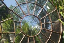 Garden Art Reflections / The use of mirrors in the garden must be done with an eye to the reflection. Feng shui principles include the analysis of reflections in creating balance and harmony in a room, letting in the good and keeping out the bad. If it's worth reflecting, it's art. / by Ann Ayers