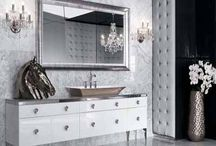 Art Deco Design Style / Streamlined, geometric style of home furnishings popular in the '20s and '30s featuring rounded fronts, mirrored accents, sleek lines and wood furniture with chrome hardware and glass tops. / by Schumacher Homes