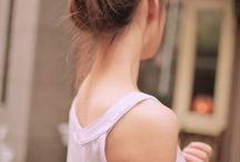 messy buns and fish tail braids... / by Melissa Haney
