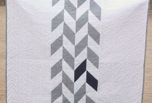 Half square triangle quilts / Ideas for how you can use half square triangles to make a modern quilt.  / by Janet Bottomley