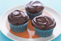 Yummy stuff / Makes 24| Hands-On Time: 15m | Total Time: 30m    Ingredients 3 large eggs 1 cup mayonnaise 1 box devil's food cake mix 1 cup water 2 teaspoons vanilla 2 cups semisweet chocolate chips 1 cup sour cream   Directions 1.Preheat oven to 350º F. Place papers in 24 muffin-tin cups. 2.In a large bowl, beat the eggs and mayonnaise. Mix in the cake mix, water, and vanilla. Divide the batter among the cups. Bake until a toothpick inserted comes out clean, about 25 minutes. Cool.  3.For the frosting, melt the chocolate chips in a double boiler; whisk in 1 cup sour cream. Frost the cupcakes immediately.  By Melissa Clark,  May 2004 / by Heather Bentz