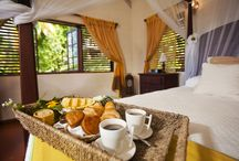 Ti Kaye Accommodation / With only 33 Creole style gingerbread cottages dotted throughout 15 acres (14 with adjoining balconies and 19 private cottages, 11 of those with private plunge pools), it is the ultimate place to relax and unwind for stunning views and sunsets across the Caribbean sea. / by Ti Kaye Resort & Spa
