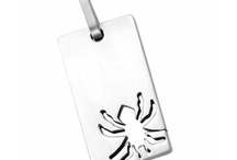 Stainless steel pendants / by Hot Buckles and Fashion Apparel