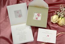 Wedding Invitations in Pockets Jackets / Bridal display of wedding invitations in pockets and jackets in various colors and styles for the bride and groom to consider sending to guests to invite them to their wedding day celebration.  / by Wedding Bedazzle