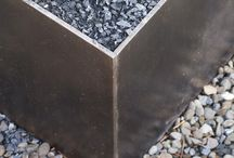 Fire Pit / A custom-designed steel and stone fire-pit heats up a backyard.