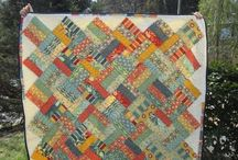 Jelly roll quilts / by Emily Robbins