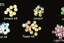 Swarovski Crystal Pendants / Swarovski Crystal products with a hole on the top to hang like a pendant. / by Berger Beads Specialty Co.
