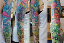 Tattooed People are just like regular people, just more colorful! / by Megan Apperson