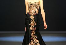 GOWNS / Who wouldn't love a reason to wear one of these gowns. / by Marnie Fuchs Martin