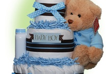 Diaper Cakes for Boys / Here's our selections of unique baby boy diaper cakes in many styles. Delight the new parents with this great gift idea. / by Lil' Baby Cakes