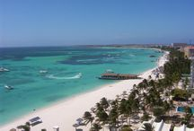 Destination : Aruba & Anguila / Aruba is a 33 km-long island of the Lesser Antilles in the southern Caribbean Sea.It has a dry climate and an arid, cactus-strewn landscape.It has a land area of 179 square kilometres (69 sq mi). It lies outside the hurricane belt. Its capital is Oranjestad.   / by Patti Taylor