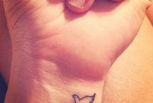 Tattoos / by Allie Ryan