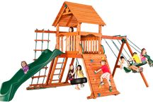 Wooden Playsets / At Backyard Discovery, our wooden play houses and swingsets will provide the perfect place for your kids to play and learn. Our play houses come with wood roofs, window trim, doors and some have neat interior accessories such as a sink, stove, and telephone. These outdoor play houses and  swingsets will release imagination within your kids. Unlike plastic, our wood play houses and swingsets won't become brittle and break when it's exposed to the sun.  / by Backyard Discovery