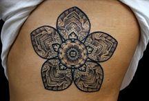 Tattoos / by Jocelyn H.