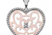 Hearts, hearts and more hearts / The simplicity and symbolism of heart-shaped jewelry.  / by Joseph Schubach Jewelers