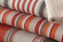 Sea Island • Stripes / From crisp and tailored to bold and graphic, this breezy collection of woven stripes blends the texture of natural yarns with clear colors inspired by earth, sea, and sky.  Patterns include classic ticking woven stripes in linen and cotton, refined awning stripes in soft hues, as well as bold and jazzy multihued stripes in textured twill weaves. These fabrics create vibrant interiors when used alone or mixed with prints and patterned weaves.  / by Schumacher — Home Décor