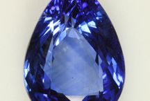 Blue Sapphires / The wonderful world of Blue Sapphires! - Sapphire (Greek: σάπφειρος; sappheiros, 'blue stone',which probably referred instead at the time to lapis lazuli) is a gemstone variety of the mineral corundum, an aluminium oxide (α-Al2O3). Trace amounts of other elements such as iron, titanium, chromium, copper, or magnesium can give corundum blue, yellow, purple, orange, or a greenish color. Chromium impurities in corundum yield a pink or red tint, the latter being called a ruby. / by TreasureForce ExpeditionHistory