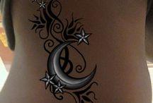 Tattoos  / by Emily Scott