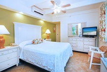 Kimball Lodge Gulfside Guest Room - Island Inn / One queen bed, private updated bath with marble, seating area, tile floors, 32 inch flatscreen LCD cable TV, DVD/CD player and wifi. Access to large sundeck for sunbathing or watching the sunset. / by Island Inn