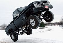 Jacked and Muddy Trucks / Everything from jacked up lifted mudding rock crawlers military spec bug out vehicles monster trucks tall show quality to just really big intimating trucks.   / by RES