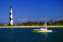 Coastal Lighthouses / Seven coastal lighthouses dot the North Carolina shoreline. Though long ago they protected adventurers from our treacherous coastline, today they draw visitors for some of the most incredible views you'll ever see. / by Visit North Carolina
