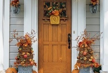 festive front doors / by MARY STRICKLAND