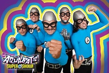 The Aquabats! / CALLING ALL KIDS!! Have the Corpo-bigwigs brought you down? Is there a force of serious bummage serving your life a steaming plate of harsh-browns? Does a lack of pure rock in your life make your tummy feel all icky inside? Well suit up, and look to the sky! No look back down! Wait, look back up! Spin around three times! 'Cuz here come THE AQUABATS!!! AGAIN!! Join this band of costume clad crime fighters as they battle all things lame in the pursuit of ultimate radness!  / by Fearless Records