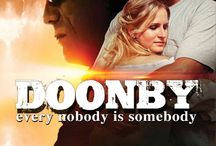 """Doonby (Movie) / (Short Synopsis) """"When a mysterious drifter arrives in a small town, he is soon met with suspicion and jealousy. Leaving as quickly as he came, the town realizes how one person's presence can make an impact.""""  (Starring) John Schneider (TV's The Dukes of Hazzard), Jenn Gotzon (Frost/Nixion), Ernie Hudson (Ghostbusters 1 & 2), Robert Davi (007: License To Kill), Joe Estevez (Meltdown) / by Green Apple Entertainment"""