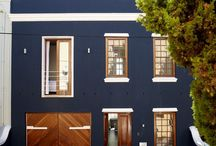 Colour Candy: Navy Blue / Navy conjures feelings of dependability, power and authority and lends an immediate sophistication to a space – particularly when you contrast with white door lintels, window details, skirting boards and moldings – but equally, navy is a colour that will complement the brown tones of natural wood grains too. / by Plascon Trends
