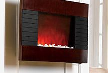 Staying Warm / From electric fireplaces to door draft stoppers, these unique products will keep you warm in the cold winter months. / by Improvements Catalog