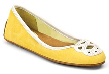 Yellow Shoes / Everyone loves that elusive, perfect yellow shoe. Here's a place to find some! No doubt one pair will be just the thing for you this summer. / by Miranda Anderson