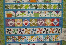 Row Quilts / by Karen Ganske