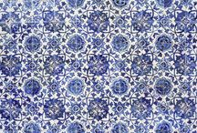 Azulejos / The most revered visual artists in Europe traditionally excelled at fresco, oil painting and sculpture. Not so in Portugal, where artists shone at making azulejos, glazed ceramic tiles that were fashioned into narrative scenes. / by Carleen Allen
