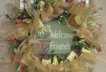 Pretty wreaths and Door decor. / by Carlena Blevins