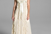 Informal & Garden Weddings / Looking for something a little different, or less formal for a big day? Our designer fashions are perfect for weddings that are by the beach and outdoors, or for receptions that are relaxed. Also perfect for debutantes and big social events. We use the softest chiffons, satins and just a touch of Swarovski crystals that keeps the styling elegant and never overdone. You'll keep our gowns in your collection for years to come.  / by Henry Roth