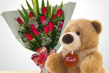 Flores, Globos y Peluches / by Latin Flores