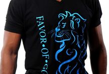 M - LION Christian T-Shirt - Black & Blue / Men, look bold with a stylish swagg in this Royal Lion F.O.G. FAVOR OF GOD Christian T-Shirt! This ribbed v-neck t-shirt, features the bold Lion design in a turquoise blue gradient color on the front of the T-shirt. It also has a wreath design at the top back of the T-shirt in a turquoise/blue print. In addition, this exclusive T-shirt features hidden letters in design of the Lion which makes it really unique and a true must have !!!  / by F.O.G. FAVOR OF GOD