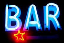 """LOBBYBAR / The term """"bar"""" is derived from the specialized counter on which drinks or food is served. Patrons may sit or stand at the bar and be served by the bartender. / by Robert Polacek"""
