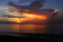 Awesome Sunsets / Every single day you can watch the most spectacular sunsets from our beach and beach deck.  Grab a drink at our Iguana Lounge and stay for dinner at our Beach Side Café / by Sand Castle on the Beach