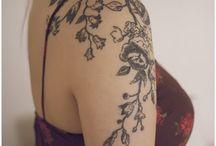 tattoos / by Hunter Woodruff
