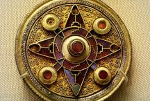 5th-7th Century CE Disc Brooches / Images of disc brooches, dated to the 5th-7th centuries CE.  Many have garnet cloissonne, or enameling, and many have an Anglo-Saxon provenance. / by Cathy Raymond