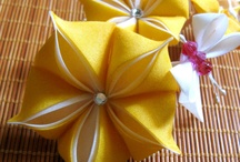 Hand Sculpted Flowers Kanzashi / Kanzashi tsumami is the Japanese art of folding delicate squares of silk into three-dimensional flower petals.  / by Susan DeLucca