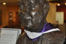 Fr. Bart / Bust of Fr. Bartley MacPhaidin at the entrance to the Library, / by Stonehill College MacPhaidin Library