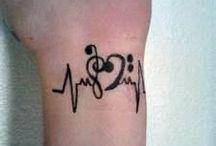 Tattoos :-) / by Misty Tunyuck